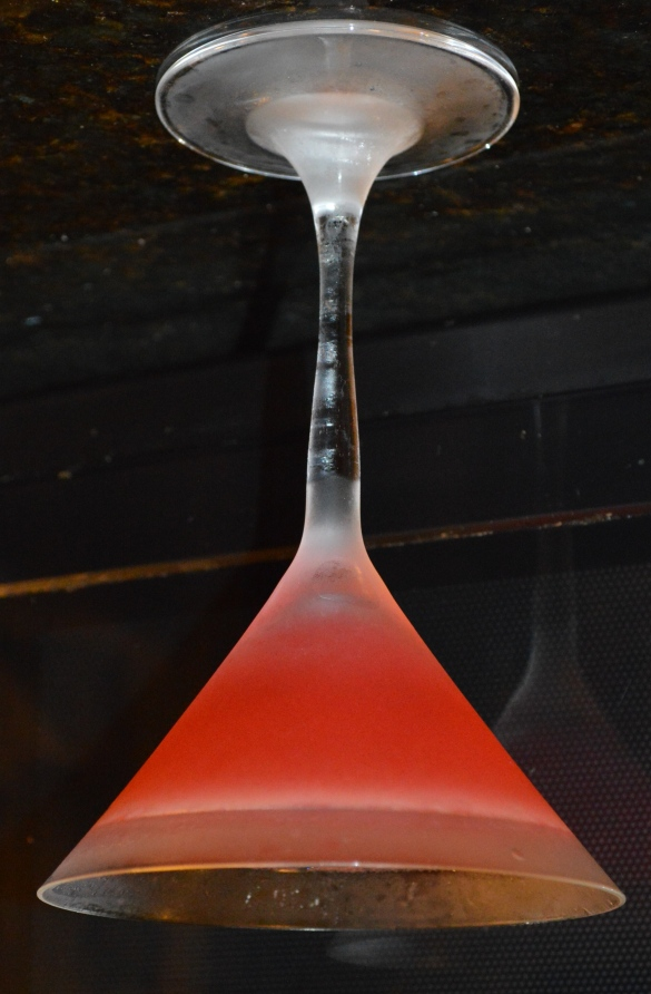 An upside-down picture of a cosmopolitan made with Hangar One Mandarine Blossom Vodka.  Notice how it doesn't spill. ;)